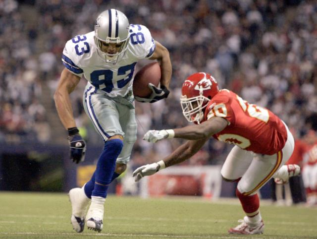 Dallas Cowboys' Terry Glenn advoids a tackle by Kansas City Chiefs corner back Benny Sapp on the way to a 6-yard touckdown run in Irving, Texas, on Sunday, Dec. 11, 2005. The Dallas Cowboys know that if they can get Terry Glenn involved, the offense will be productive. (AP Photo/Donna McWilliam) 640x482.1333333333333