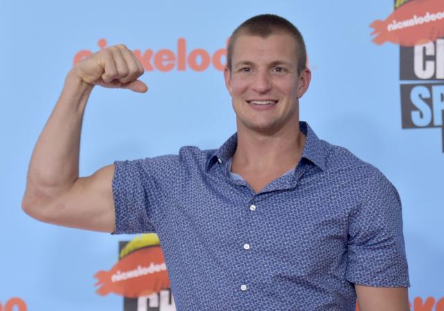 NFL player Rob Gronkowski, of the New England Patriots, arrives at the Kids' Choice Sports Awards on Thursday, July 11, 2019, at the Barker Hangar in Santa Monica, Calif. (Photo by Richard Shotwell/Invision/AP) 640x448.50174216027875